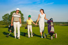 Family playing golf Stock Photos