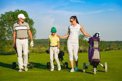 Family playing golf royalty free stock photography