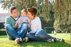 Family playing on grass Stock Photos