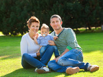 Family playing on grass Stock Photography