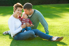 Family playing on grass Royalty Free Stock Photo
