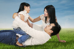 Family playing on green grass Stock Images