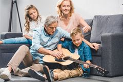 Family playing on guitar Stock Image