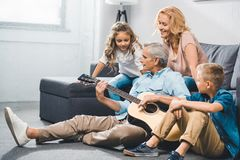 Family playing on guitar Royalty Free Stock Photos