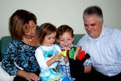 Family playing with hand puppets Royalty Free Stock Image