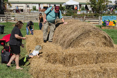 Family Playing on Hay Bales Royalty Free Stock Image