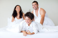 Family playing with his son in bed Royalty Free Stock Photo