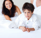 Family playing with his son in bed. Happy family playing with his son in bed Royalty Free Stock Photo