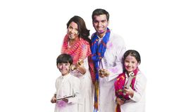 Family playing holi. Portrait of a family playing holi and smiling Royalty Free Stock Images