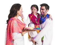 Family playing holi Royalty Free Stock Photography