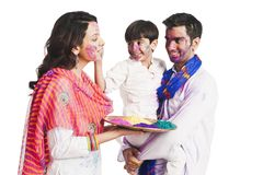 Family playing holi Stock Photos