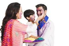 Family playing holi Stock Images