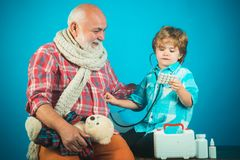 Free Family Playing In Doctor And Patient. Childhood. Kid Play Doctor With Dad On Color Background. Medicine Age And Health Royalty Free Stock Photos - 160897368
