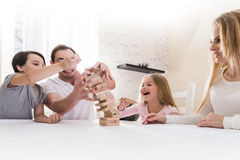 Family playing Jenga Stock Image