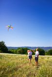 Family playing with kite Stock Image