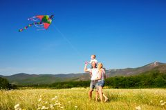 Family playing with kite. On the flower meadow Royalty Free Stock Photography