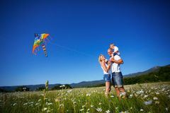Family playing with kite Royalty Free Stock Photography