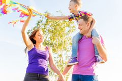 Family playing with a kite Stock Photography