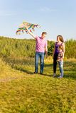 Family playing with a kite Stock Image