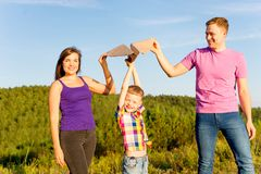 Family playing with a kite Royalty Free Stock Photo