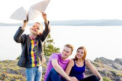 Family playing with a kite Stock Images