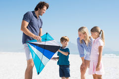 Family playing with kite royalty free stock image