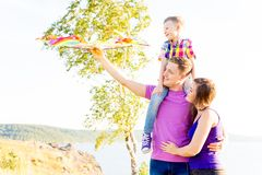Family playing with a kite Stock Photo