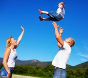 Family playing with kite Royalty Free Stock Photo