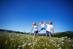 Family playing with kite Royalty Free Stock Images