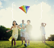Family Playing Kite Summer Outdoors Leisure Concept Royalty Free Stock Photography