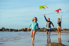 Family playing with kite in a summer vacation Stock Images