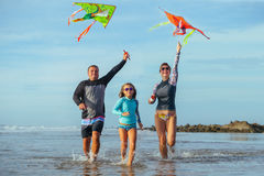 Family playing with kite in a summer vacation Stock Image
