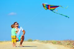 Family playing with kite, summer vacation Royalty Free Stock Photo