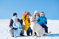 Family playing with Labrador Royalty Free Stock Photography