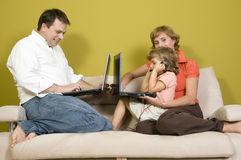 Family playing with laptops Stock Photography