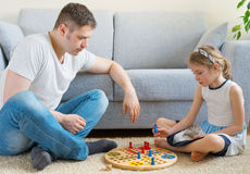 Family playing ludo. Royalty Free Stock Photos