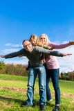 Family playing on meadow in fall Stock Images