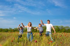 Family playing on the meadow royalty free stock photos