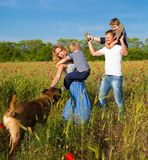Family playing on the meadow Royalty Free Stock Images