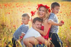 Family playing on the meadow Royalty Free Stock Photo
