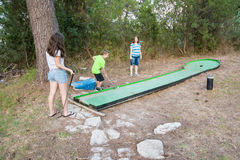 Family playing miniature golf in the North of Israel Stock Photo