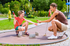 Family playing miniature golf Stock Photography