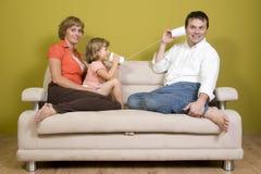 Family playing with mug phone Stock Photos