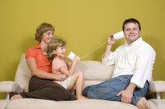 Family playing with mug phone Royalty Free Stock Photography