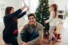 Family having fun together on Christmas. Royalty Free Stock Image
