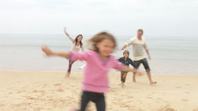 Free Family Playing On Fall Beach Together Stock Photo - 57535800