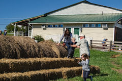 Free Family Playing On Hay Bales Stock Images - 78288824