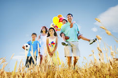 Family Playing Outdoors Children Field Concept.  royalty free stock photography
