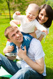 Family playing in park Royalty Free Stock Images