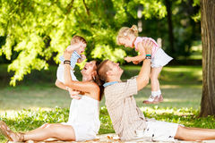 Family Playing In The Park Stock Photography
